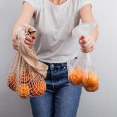 woman handling mesh bag and plastic bag